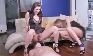 Crazy Russian femdom - two mistresses pee onto their slave