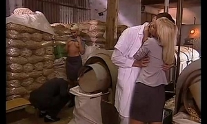 Sexual orgy in a factory with two flaxen-haired sluts