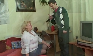 Enormous age-old grandma gives head and rides dick